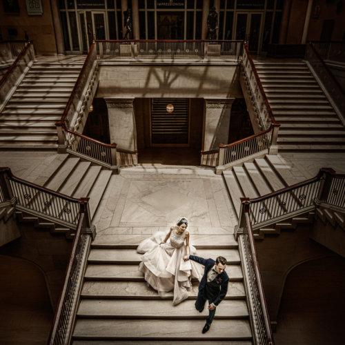Wedding couple walking down steps