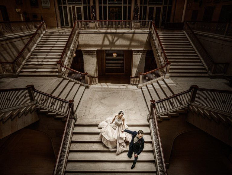 Wedding couple walking down steps