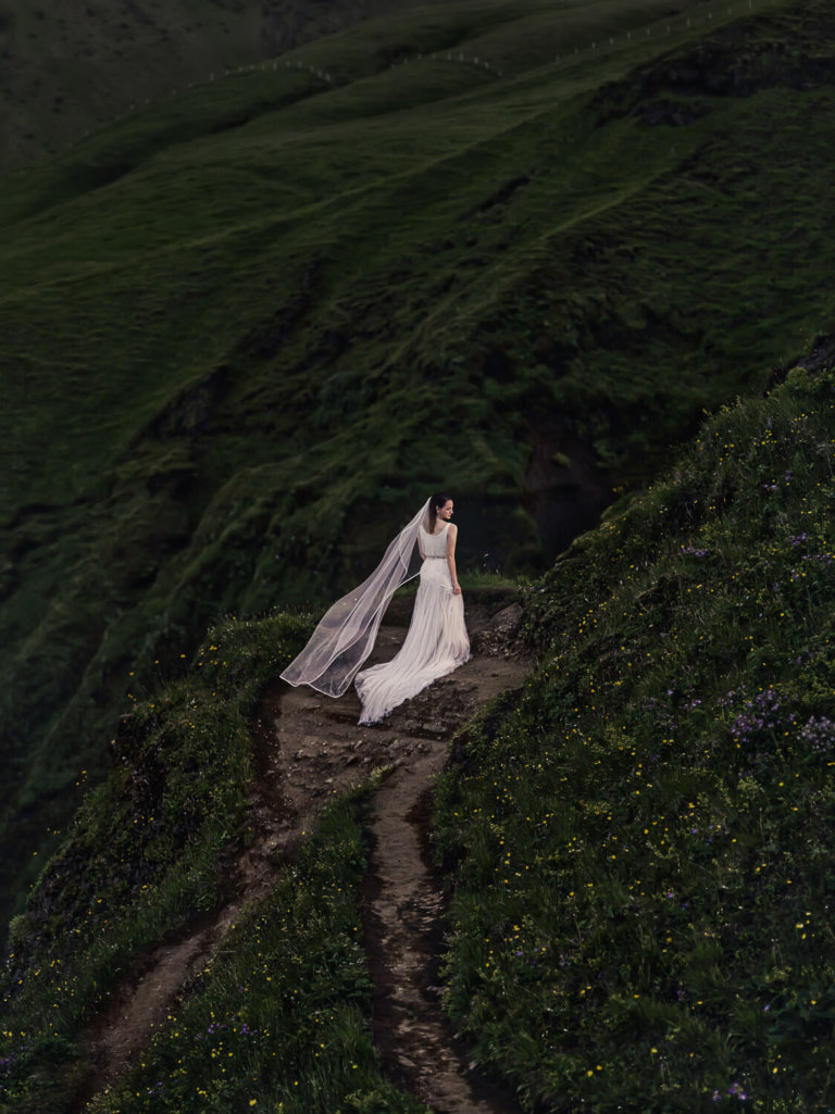 Bride in on a cliff in Iceland