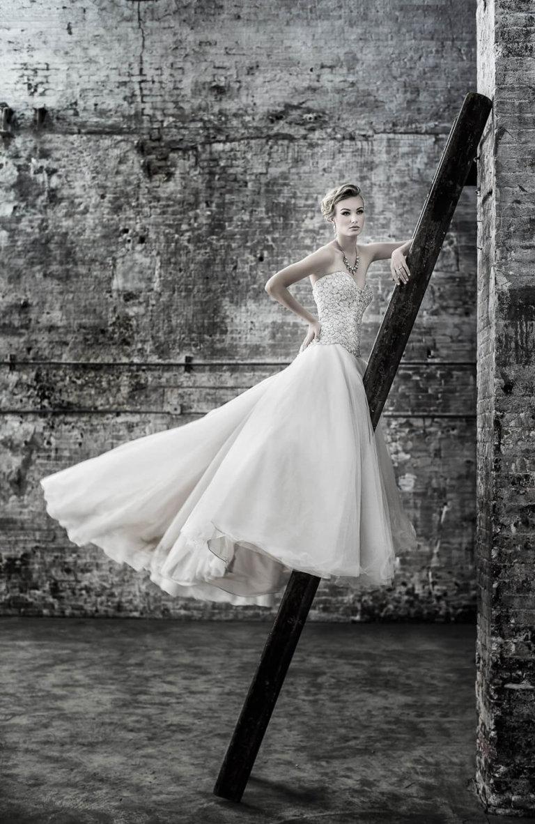 Bride in a wedding dress on a ladder