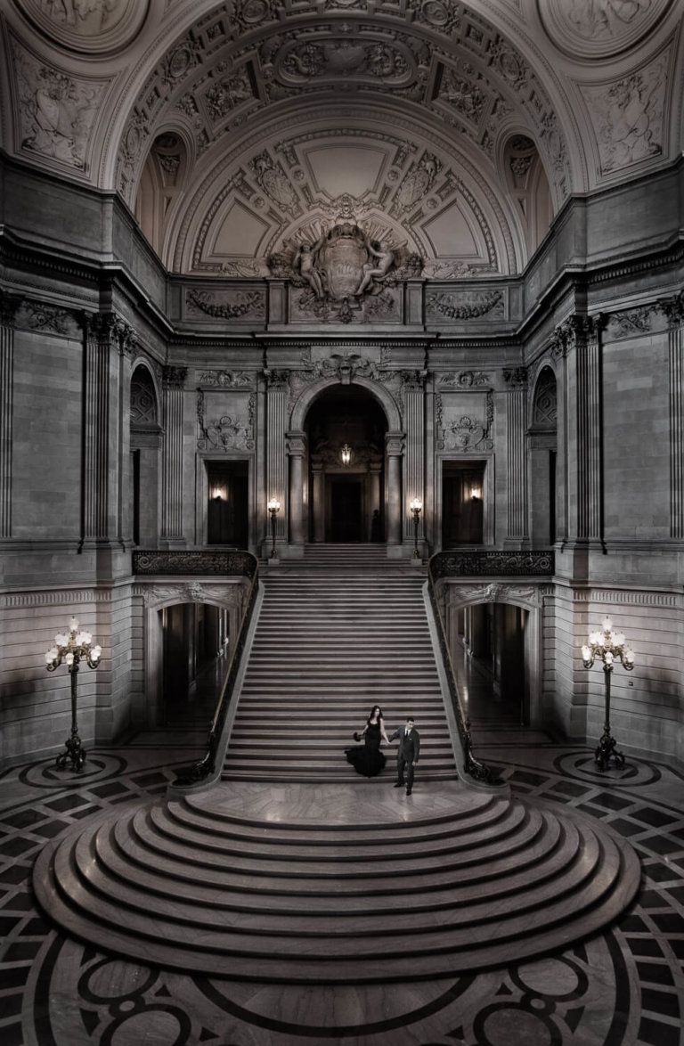Bride & Groom walking down steps in a large building