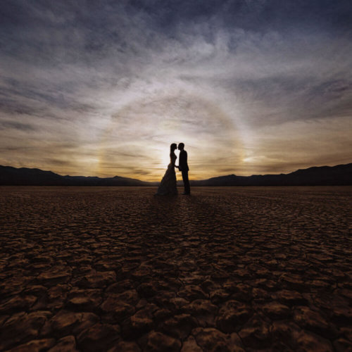 silhouette of bride & groom in the desert