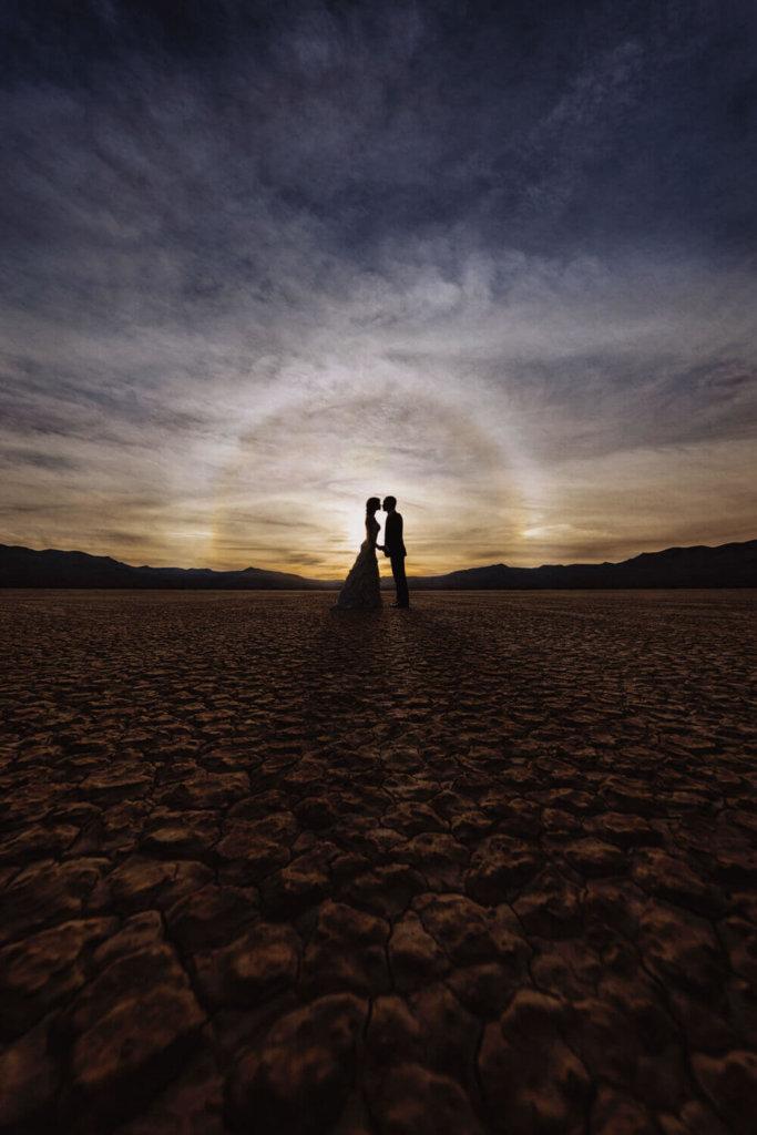 silhouette of bride & groom in the desert